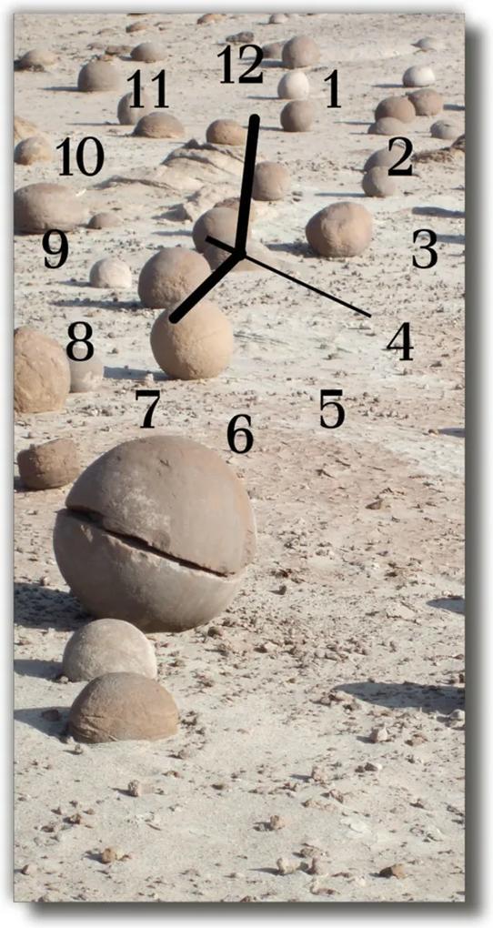 Skleněné hodiny vertikální Zobrazit kameny na béžové pláži