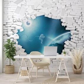 Fototapeta - Tehlová stena a astronaut vo vesmíre (254x184 cm), 10 ďalších rozmerov